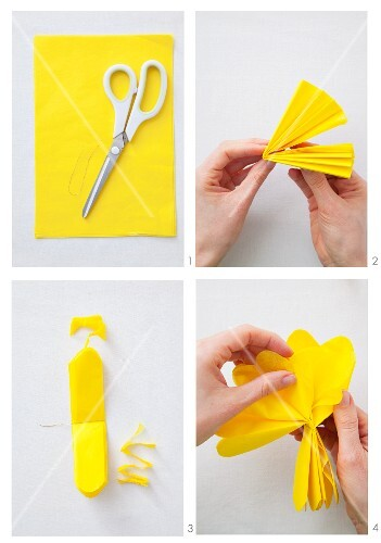A pompom being made with yellow paper