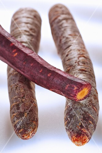 Three heritage carrots, partly peeled