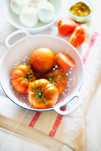 Fresh tomatoes in a colander