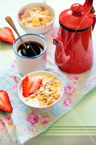 Muesli with strawberries, a cup of coffee