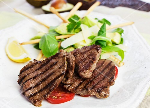 Barbecued beef steaks with avocado salad