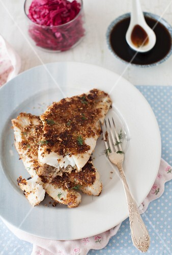 Fried orange roughy fillets with a sesame and walnut crust