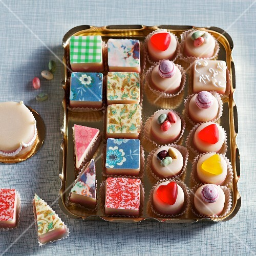 Colourful petits fours on a gold tray