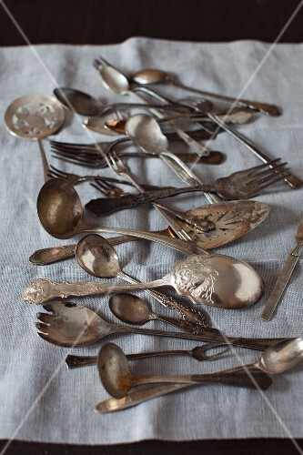 Old Spoons and Forks on Linen