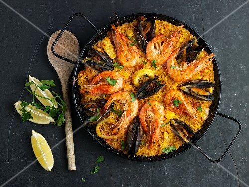Paella decorated with mussels and prawns