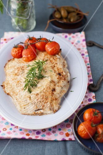 Baked Skate with Roasted Tomatoes on a White Plate