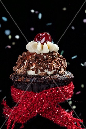 A chocolate cupcake with a red woollen scarf for the New Year