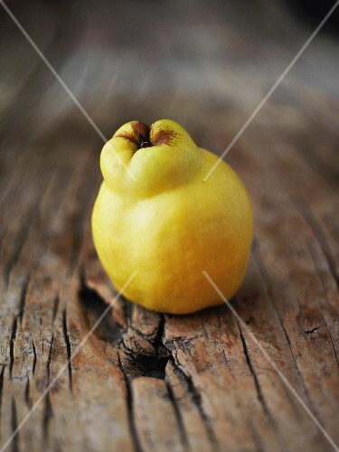 A quince on a wooden background