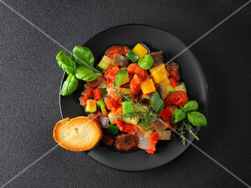 Ratatouille on a black plate