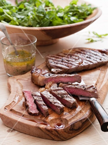 Grilled beef steak with a rocket salad