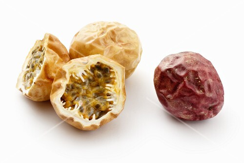 Red and yellow passion fruit, whole and halved