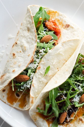 Burritos filled with rocket and almonds