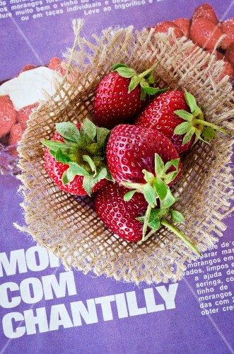 Fresh strawberries on a piece of hessian