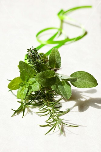 A bunch of herbs with mint, thyme, rosemary and sage