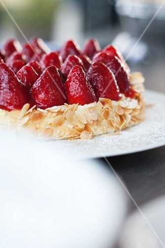 Strawberry torte with slivered almonds