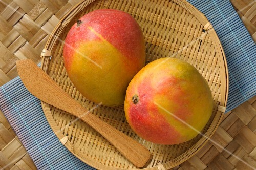 Two mangos in a basket