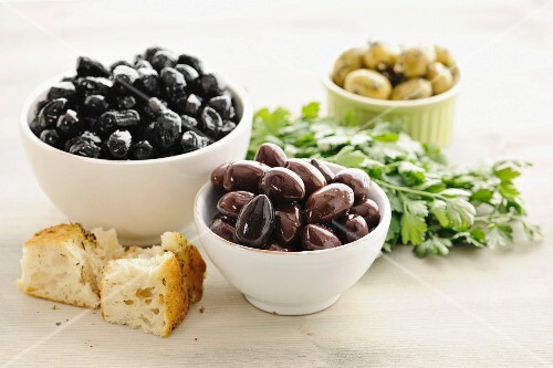 Kalamata olives in bowls, with bread and parsley