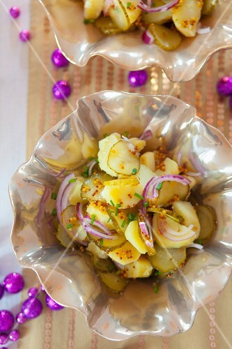Potato salad with pickled gherkins, onions, mustard and chives for New Year