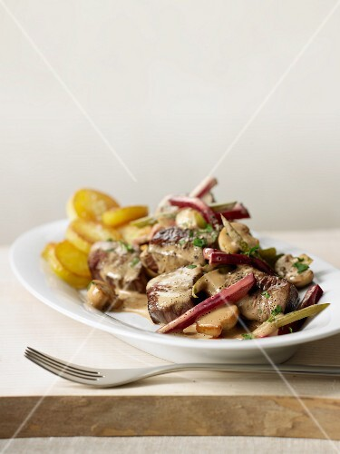 Beef Stroganoff with mushrooms, red beets and roast potatoes