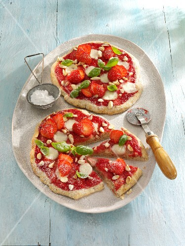 Small strawberry pizzas with basil