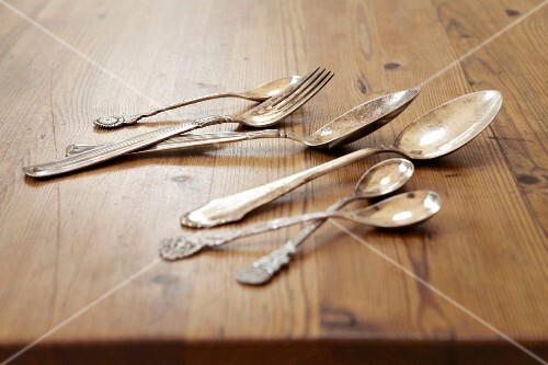 Silver cutlery on a wooden table