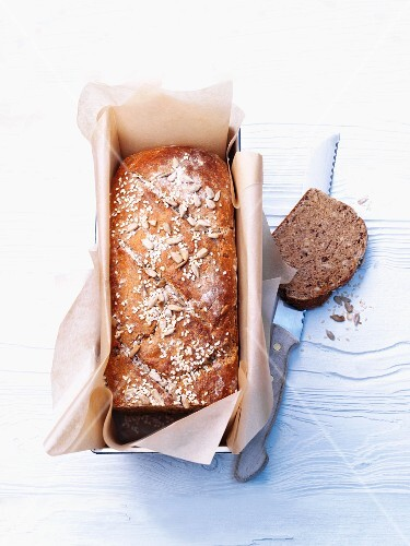 Healthy wholegrain bread in a loaf tin