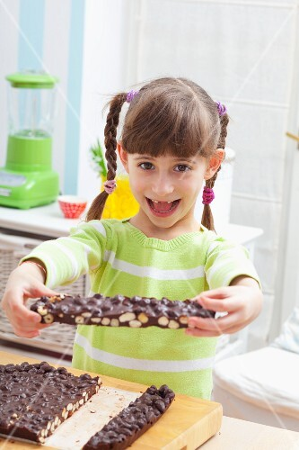 A girl holding home-made nut chocolate