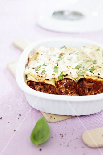 Cannelloni topped with feta and baked