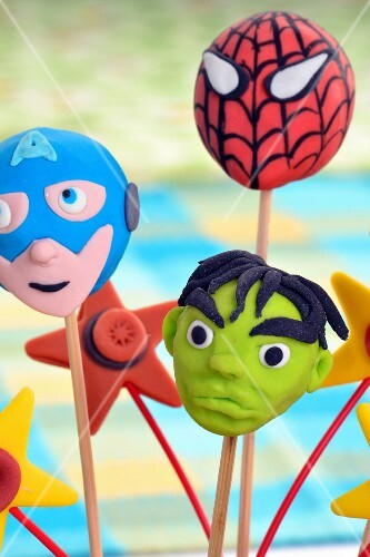 Cake pops decorated to look like superheroes