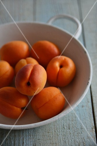 Apricots in a grey bowl