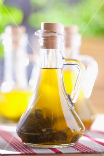 Olive oil with sage in a bottle