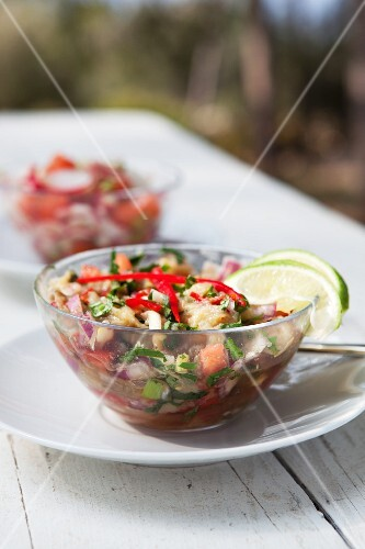 Aubergine and pepper salad garnished with limes