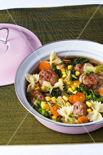 A stew of savoy cabbage, meatballs and farfalle