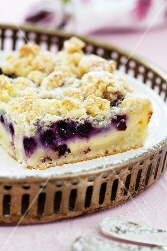 Blueberry crumble cake on a tray