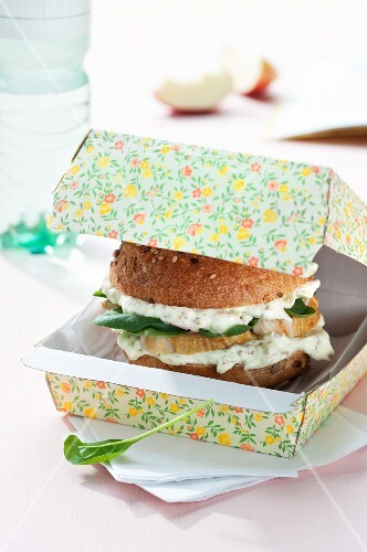 Wholemeal burger bun filled with apple quark, chicken breast and spinach