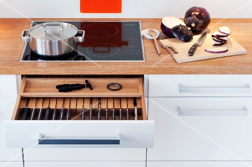 A knife draw beneath the hob in the kitchen