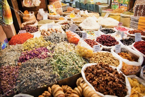 Market stall with herbs, spices and other groceries (Syria)