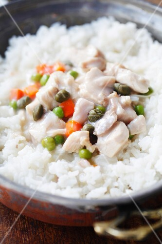 Chicken fricassee with rice in a copper bowl