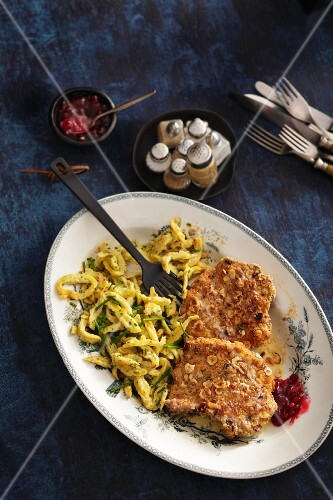 Pork chop with hazelnut breadcrumb coating and herb Spätzle (soft egg noodles from Swabia)