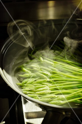 Wild asparagus being boiled in water