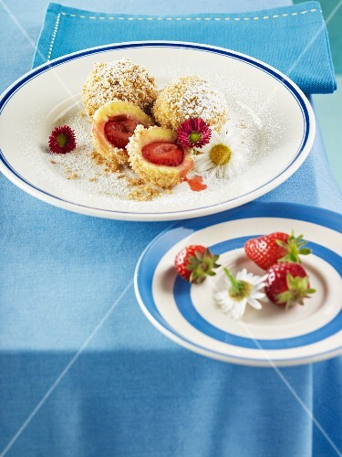 Strawberry dumplings with buttered breadcrumbs and icing sugar