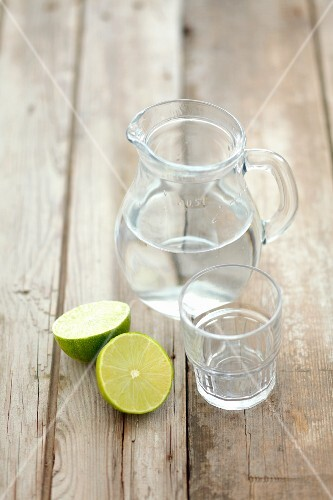 Water in a jug and limes
