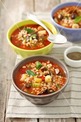 Tomato and barley soup with mushrooms