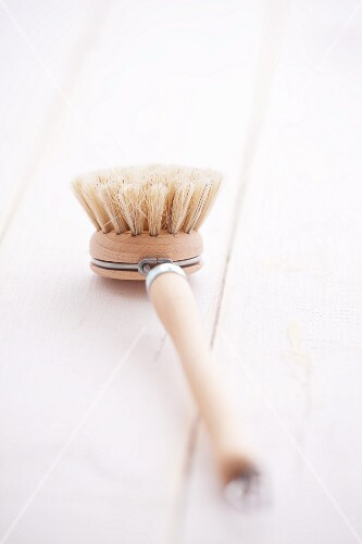A wooden washing-up brush