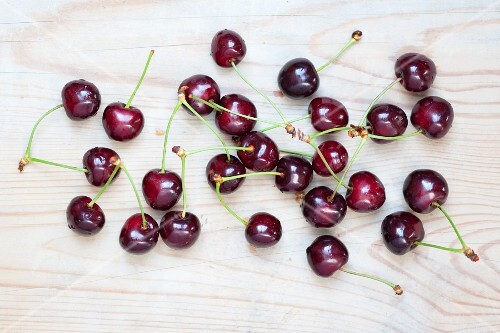 Cherries on a wooden surface