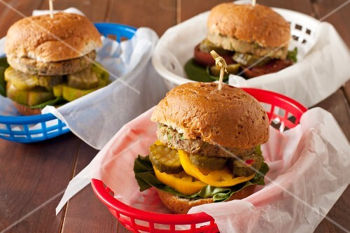 Chickpea Veggie Burgers with Pickles and Heirloom Tomatoes in Plastic Baskets