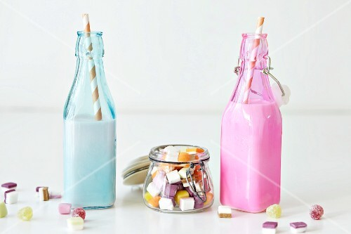 Strawberry shakes in two bottles, and dolly mixtures
