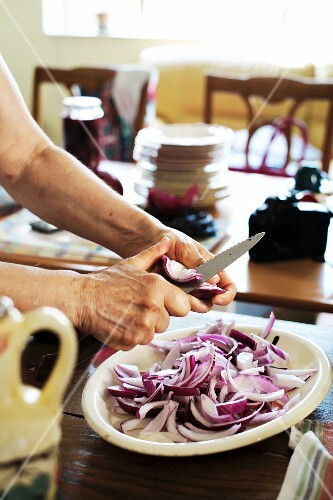 Red onions being cut into small pieces