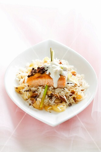 Salmon fillet with cream sauce on spiced rice