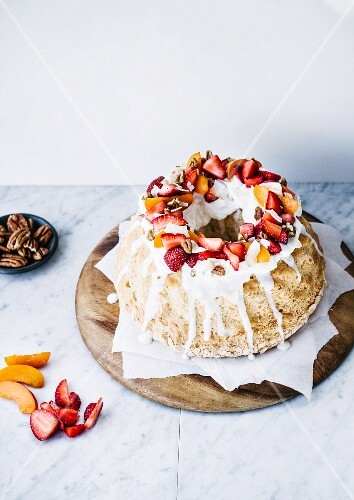 Angel food cake with fruit and pecan nuts